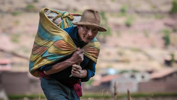 Peruvian farmer in Pisac stock photo