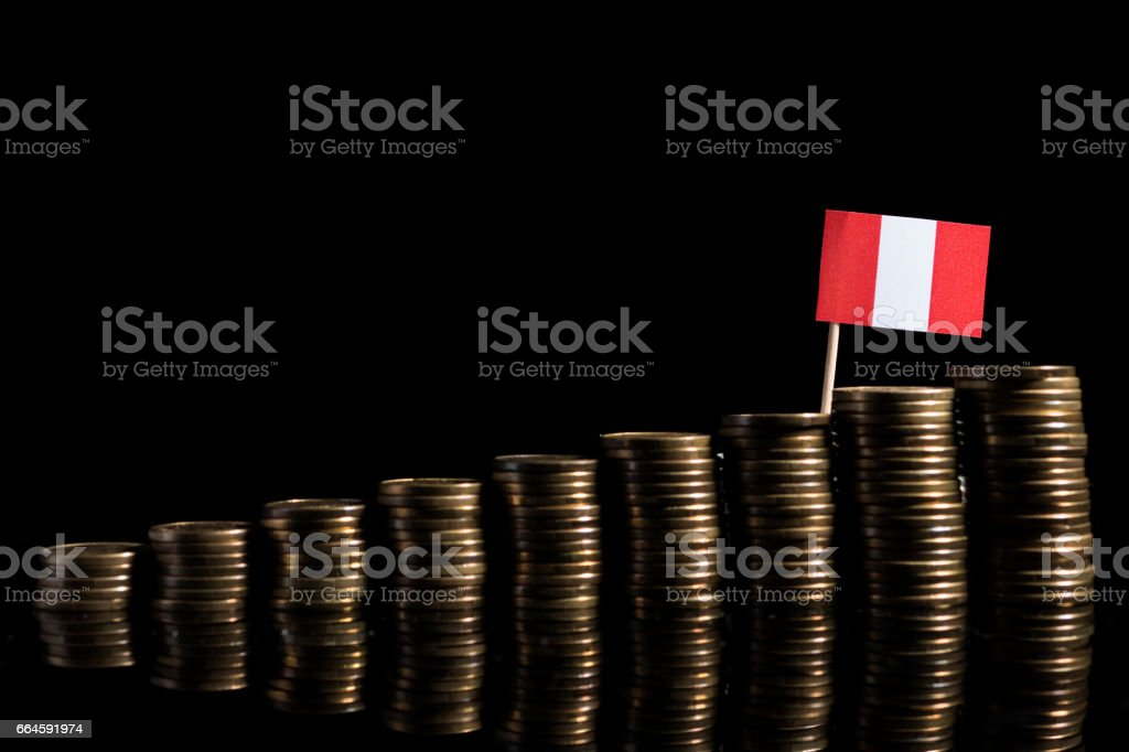 Peruvian flag with lot of coins isolated on black background stock photo