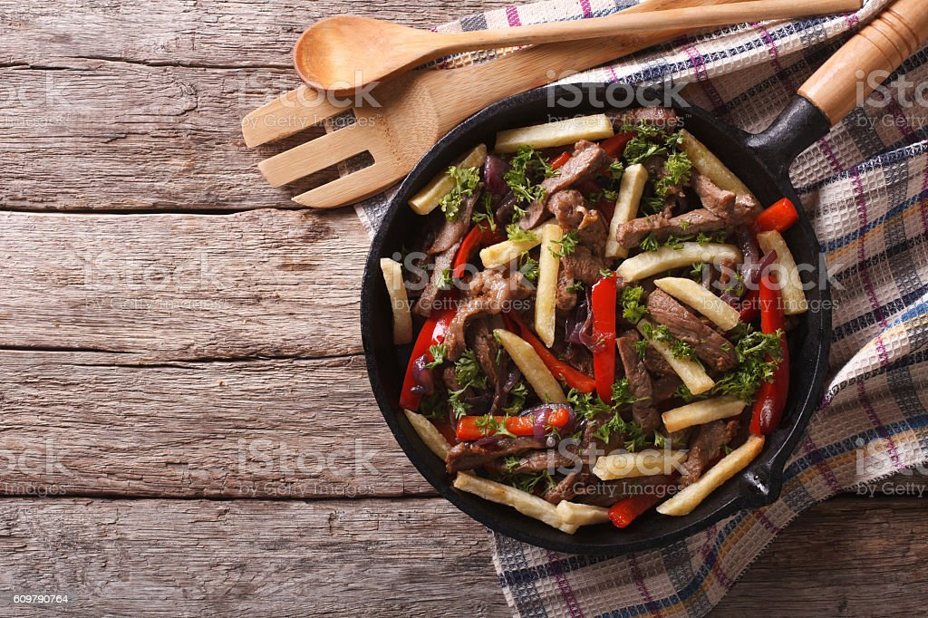 Peruvian Food: Lomo saltado in frying pan. horizontal top view stock photo