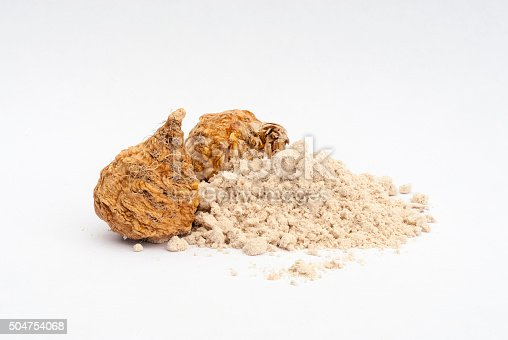Peruvian ginseng or maca (Lepidium meyenii), dried root and  powder on wooden table