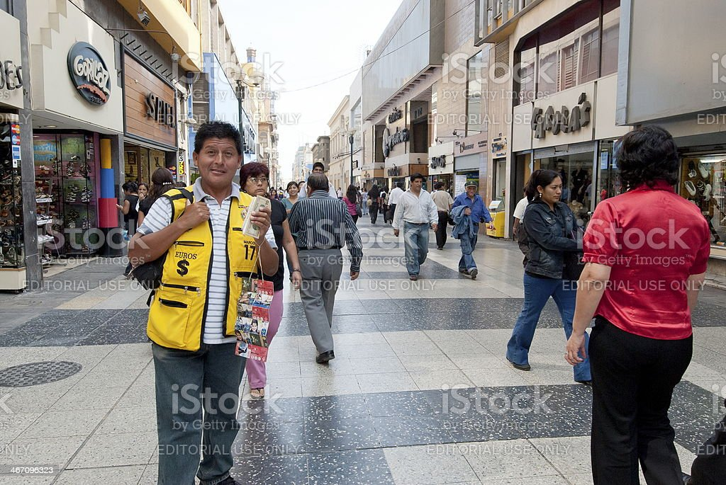 Peruvian man offers exchange foreign currency in Lima, Peru. stock photo