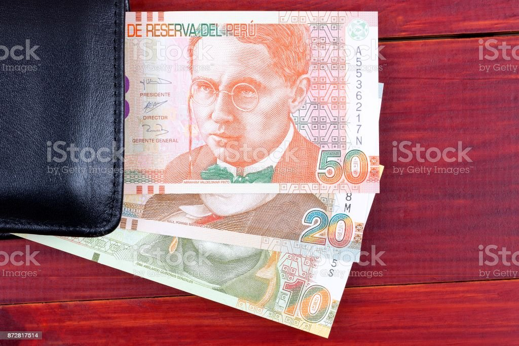 Peruvian money in the black wallet stock photo