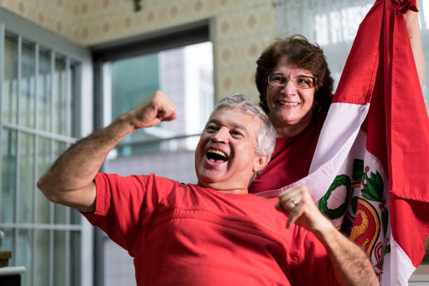 peruvian senior couple fan watching soccer game at home - peruvian ethnicity stock pictures, royalty-free photos & images