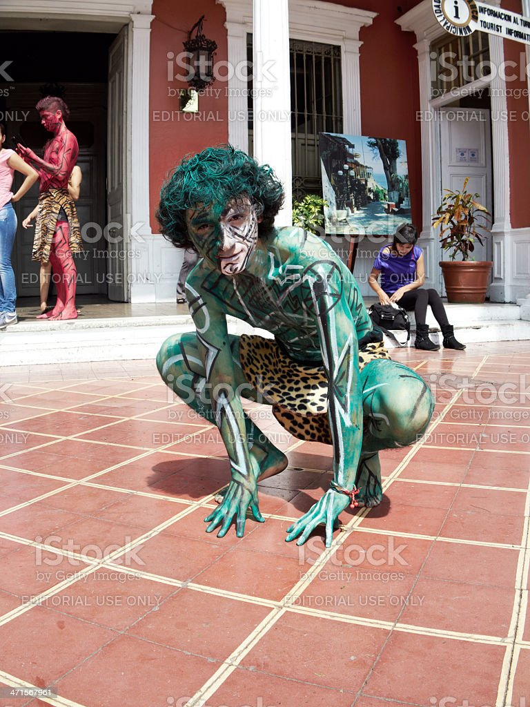 Peruvian street dancer in green body paint stock photo