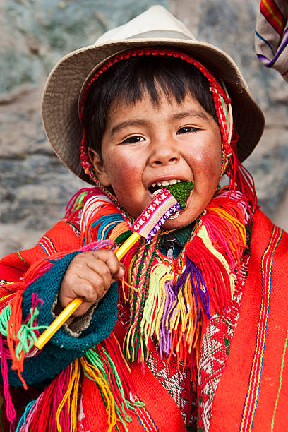 Peruvian with her child, The Sacred Valley, Cuzco stock photo