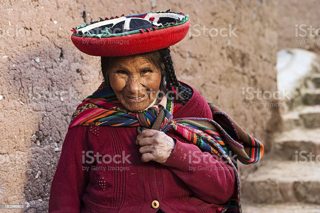Peruvian woman at Inca ruins, The Sacred Valley, Peru royalty-free stock photo