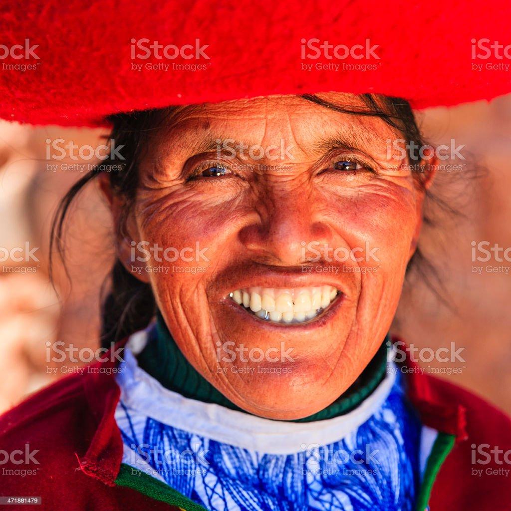 Peruvian woman at Inca ruins, The Sacred Valley, Peru royalty-free stock photo