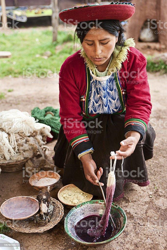 Peruvian woman dyeing wool, The Sacred Valley, Chinchero stock photo