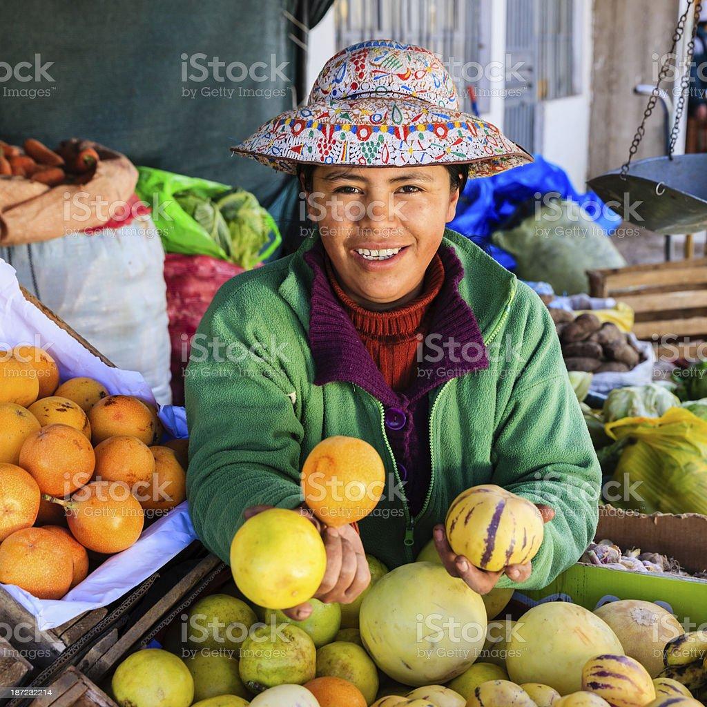 Peruvian woman selling fruits, Chivay stock photo