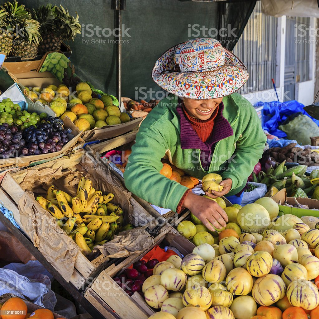 Peruvian woman selling fruits, Chivay stock photo