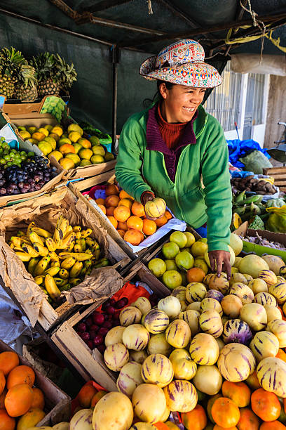 peruvian woman selling fruits, chivay - peruvian ethnicity stock pictures, royalty-free photos & images