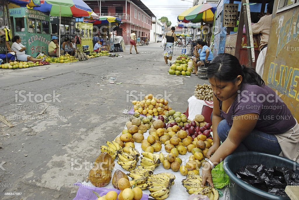 Peruvian woman sells exotic fruits on a street, Iquitos, Peru. royalty-free stock photo