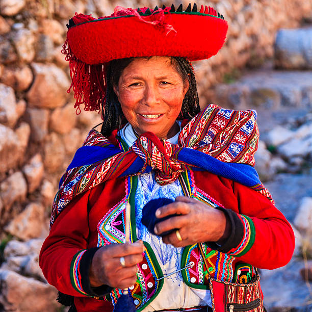 Peruvian woman spinning wool by hand, Sacred Valley, Peru stock photo