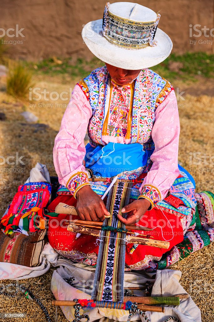 Peruvian woman weaving near Colca Canyon, Peru stock photo
