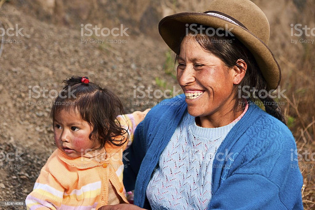 Peruvian woman weaving near Pisac, The Sacred Valley stock photo