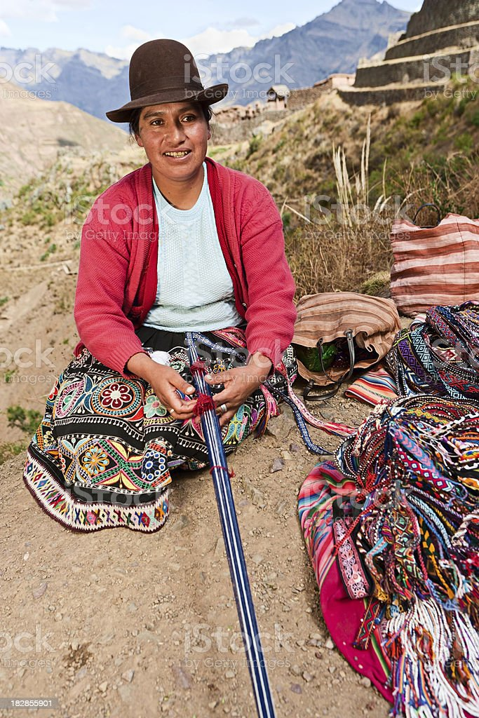 Peruvian woman weaving near Pisac, The Sacred Valley stock photo