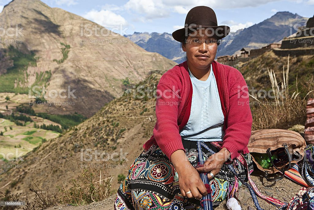 Peruvian woman weaving near Pisac, The Sacred Valley royalty-free stock photo
