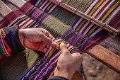 istock Peruvian woman weaving, The Sacred Valley, Chinchero 1281680639