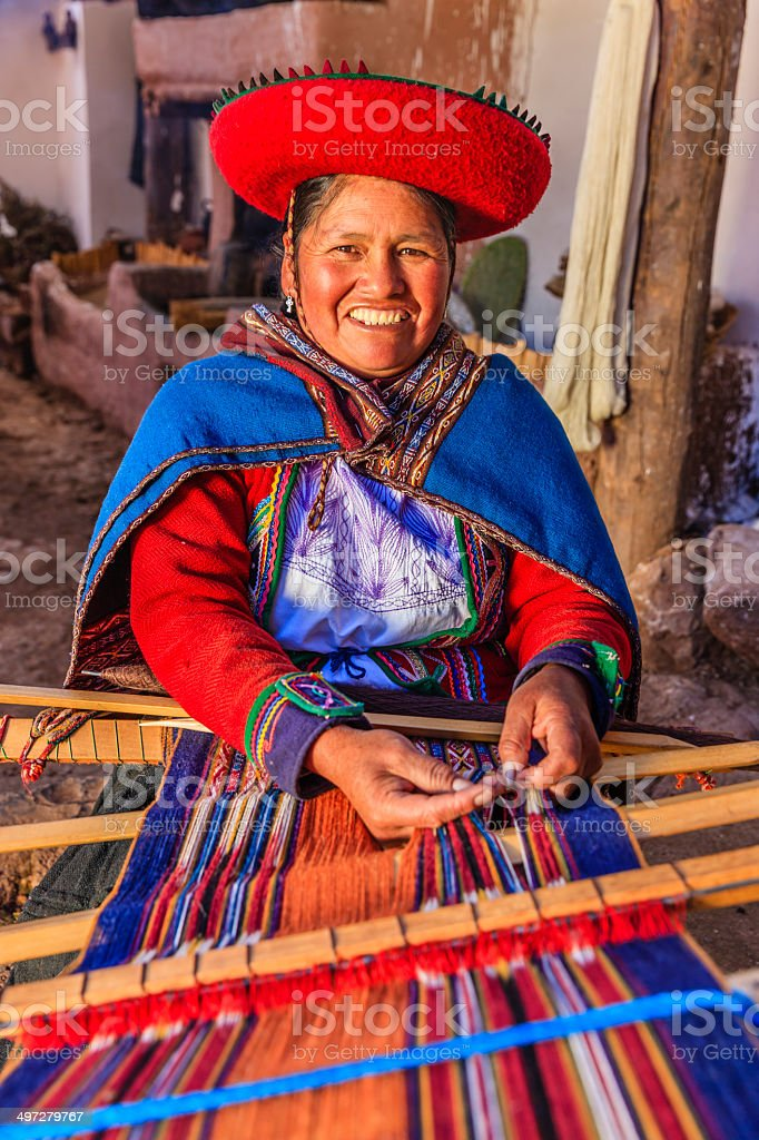 Peruvian woman weaving, The Sacred Valley, Chinchero - Royalty-free Adult Stock Photo