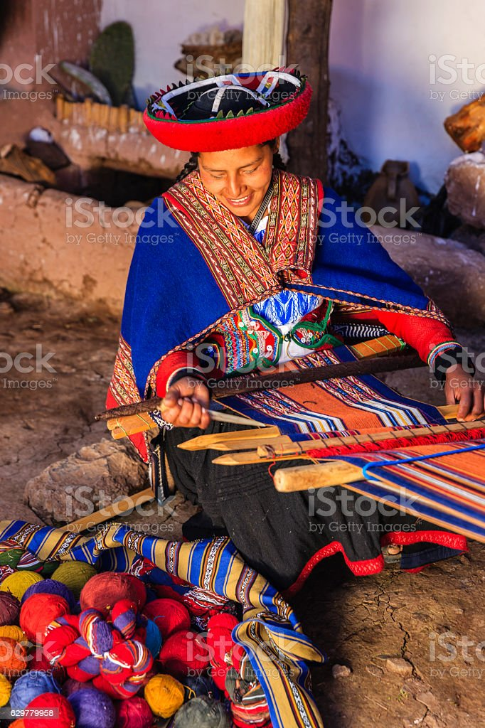 Peruvian woman weaving, The Sacred Valley, Chinchero stock photo