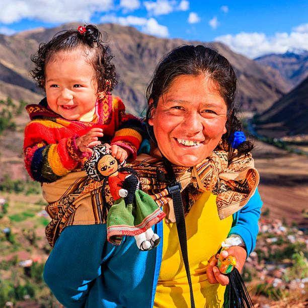peruvian woman with her baby on the back near pisac - peruvian ethnicity stock pictures, royalty-free photos & images