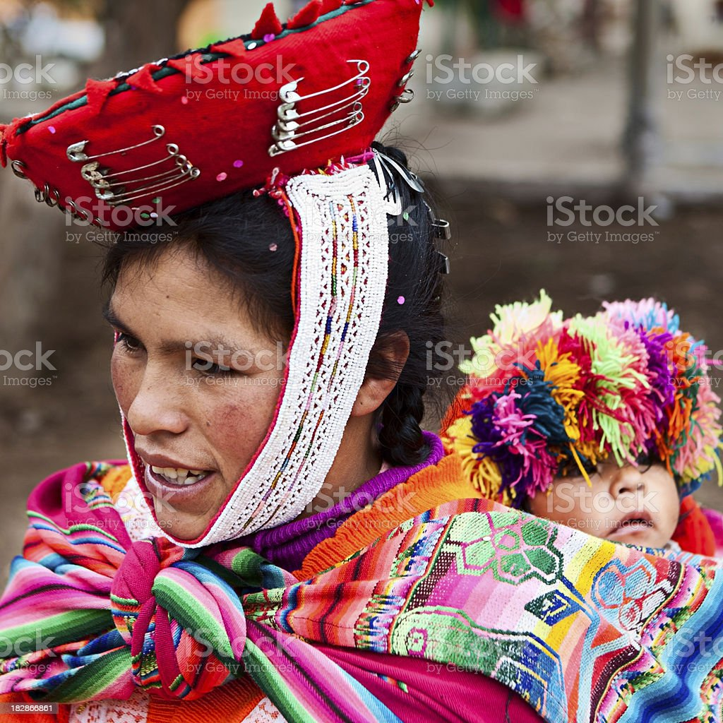 Peruvian woman with her baby on the back, Ollantaytambo royalty-free stock photo
