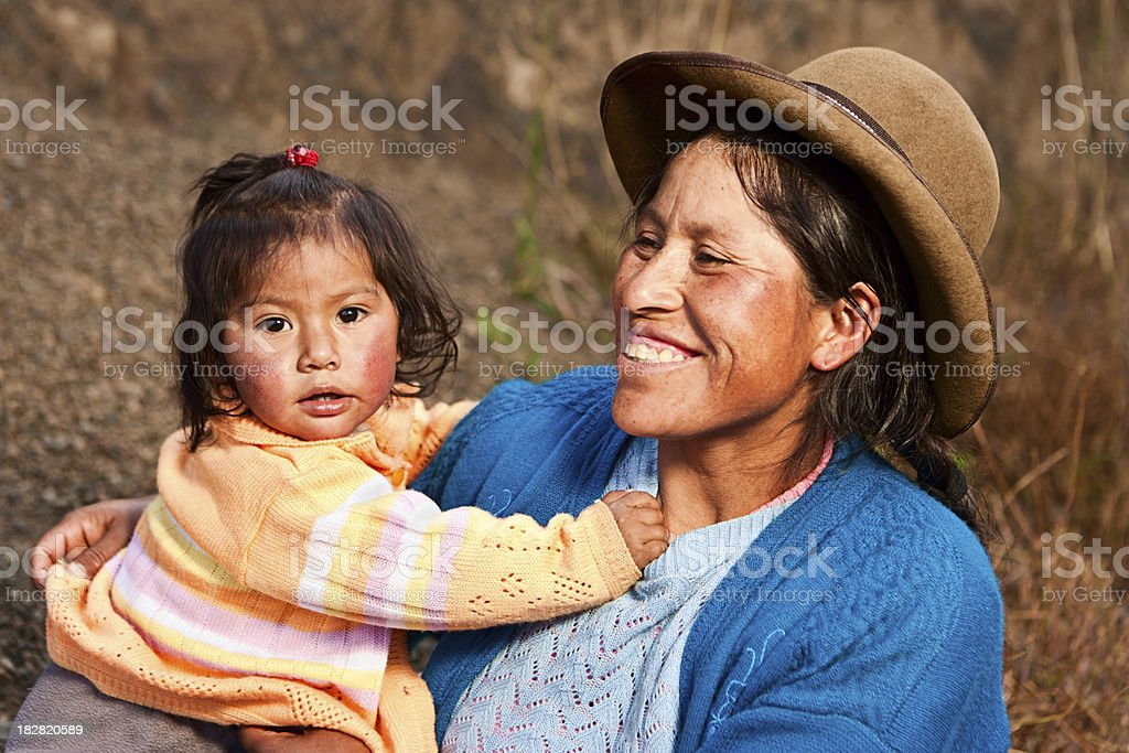 Peruvian woman with her baby, Pisac, The Sacred Valley stock photo