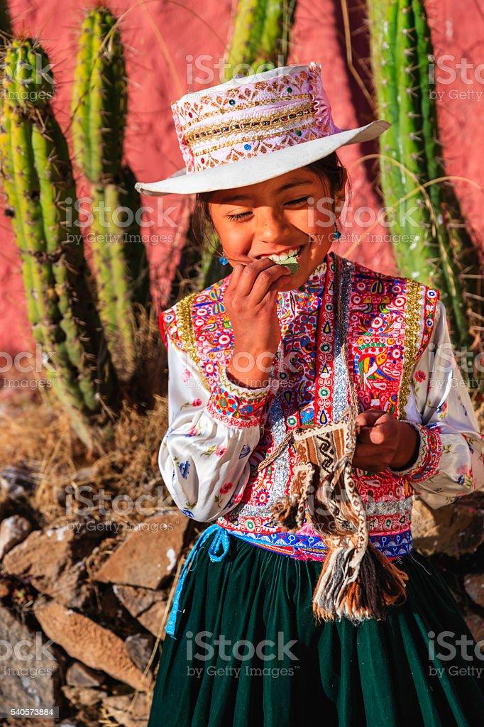 Peruvian young girl chewing coca leaves, Chivay, Peru stock photo