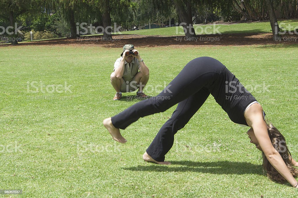 Pervert Watching A Woman in the Park royalty-free stock photo