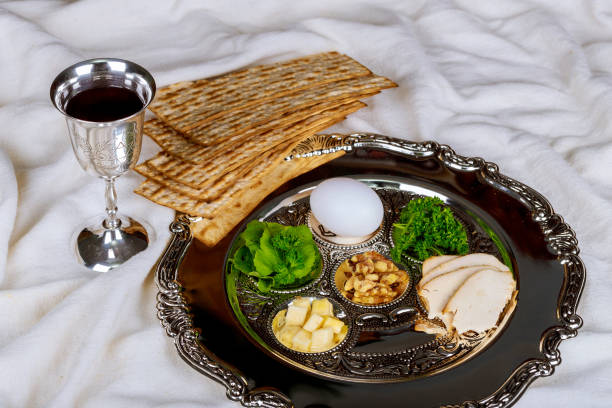 Pesah celebration concept jewish Passover holiday Pesah celebration concept jewish Passover holiday egg and seder plate seder plate stock pictures, royalty-free photos & images