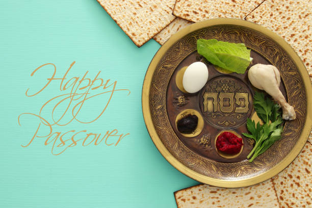 Pesah celebration concept (jewish Passover holiday) Pesah celebration concept (jewish Passover holiday). Traditional pesah plate with five symbols: horseradish, celery, egg, bone, maror, charoset. Text in hebrew: Passover passover stock pictures, royalty-free photos & images