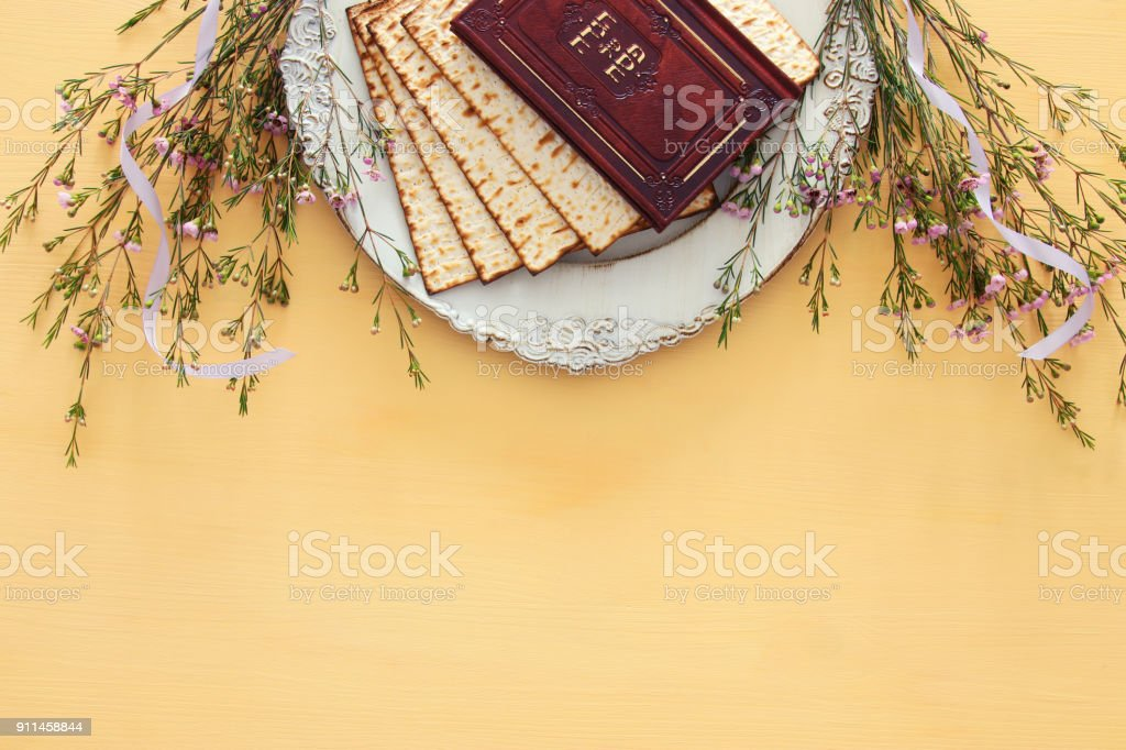 Pesah celebration concept (jewish Passover holiday). Traditional book with text in hebrew: Passover Haggadah (Passover Tale). stock photo