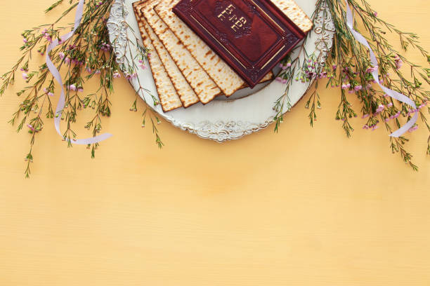 pesah celebration concept (jewish passover holiday). traditional book with text in hebrew: passover haggadah (passover tale). - passover stock photos and pictures
