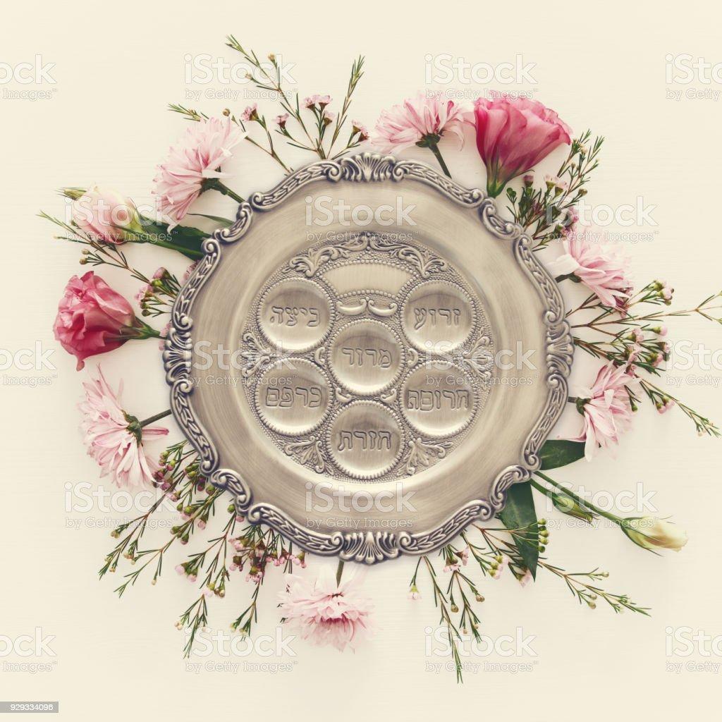 Pesah celebration concept (jewish Passover holiday). Traditional pesah plate with five symbols: horseradish, celery, egg, bone, maror, charoset. stock photo