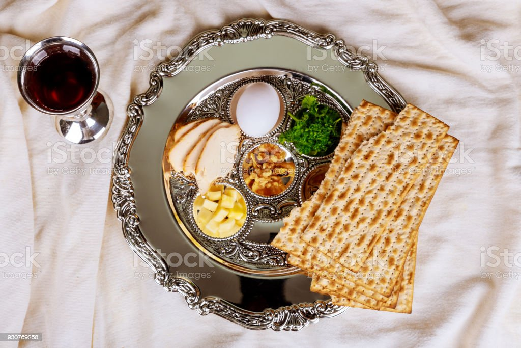 Pesah celebration Passover holiday. Traditional pesah plate text in hebrew: Passover, egg, stock photo