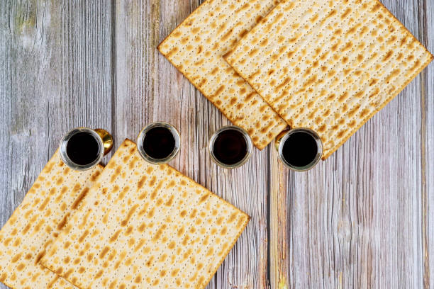 Pesah holiday celebration, matza unleavened bread and four cup kosher wine Pesah holiday celebration, matza unleavened bread and four cup kosher wine, jewish Passover holiday seder plate stock pictures, royalty-free photos & images