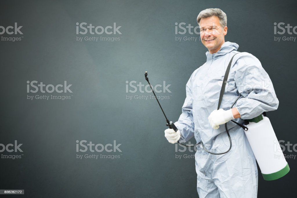 Pest Control Worker In Protective Workwear stock photo