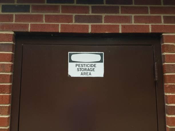 pesticide storage area sign on door stock photo