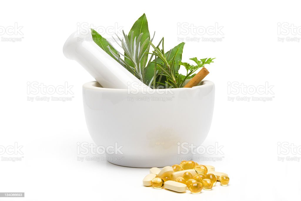 Pestle and Mortar with Herbal Complementary Medicine stock photo