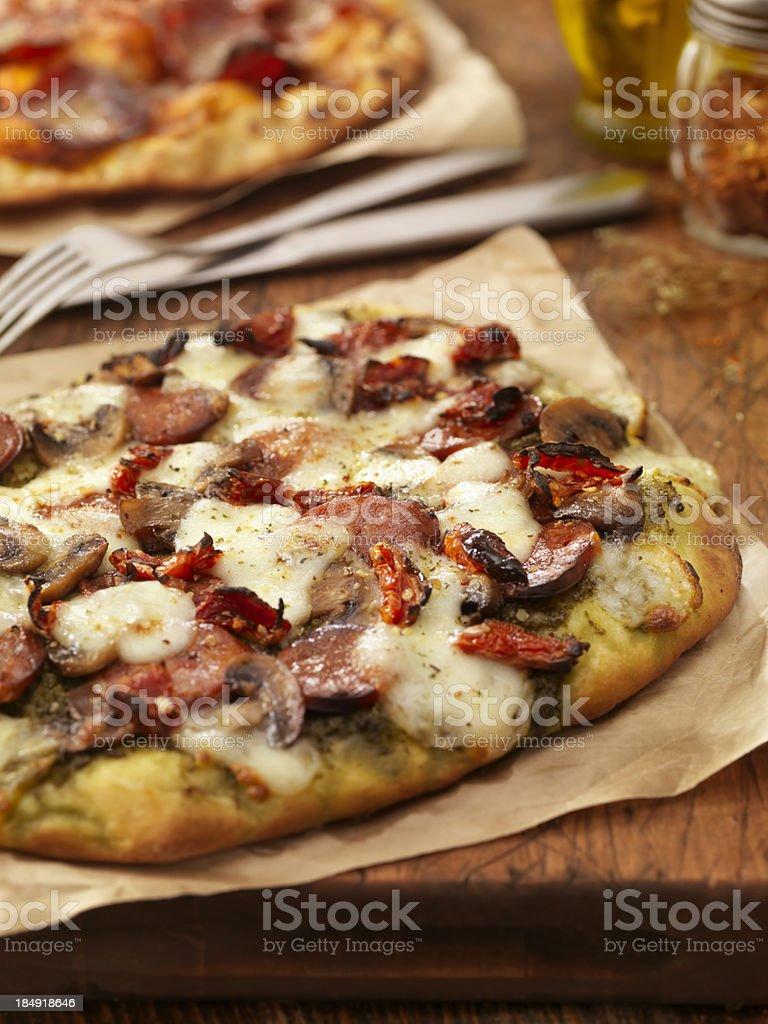 Pesto and Chorizo Sausage Pizza stock photo