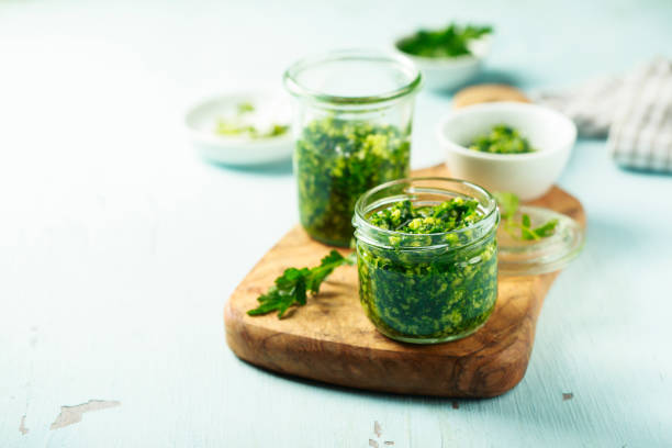 Pesto sauce Homemade pesto sauce in the jars cilantro stock pictures, royalty-free photos & images