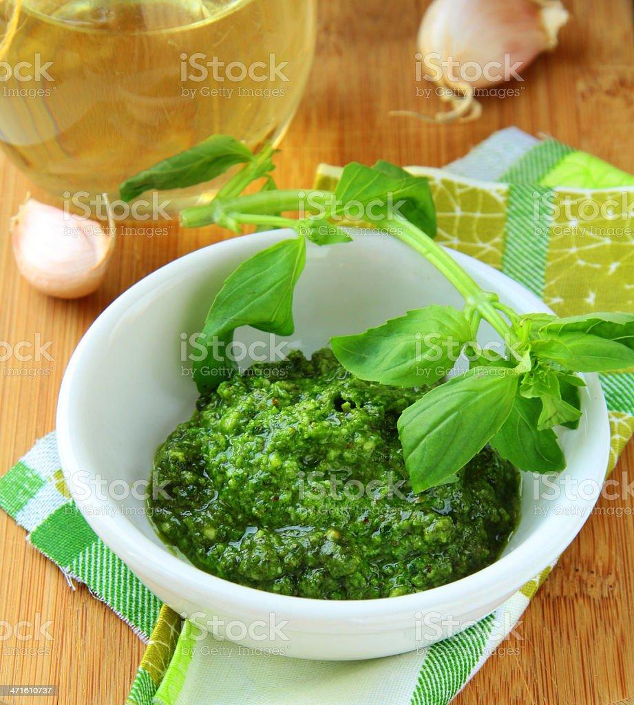pesto sauce with fresh green basil royalty-free stock photo