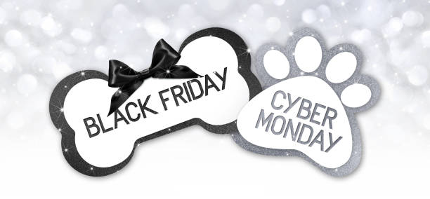 pet shop black friday and cyberg monday sale text write on gift card label with black ribbon bow on silver bright lights background stock photo
