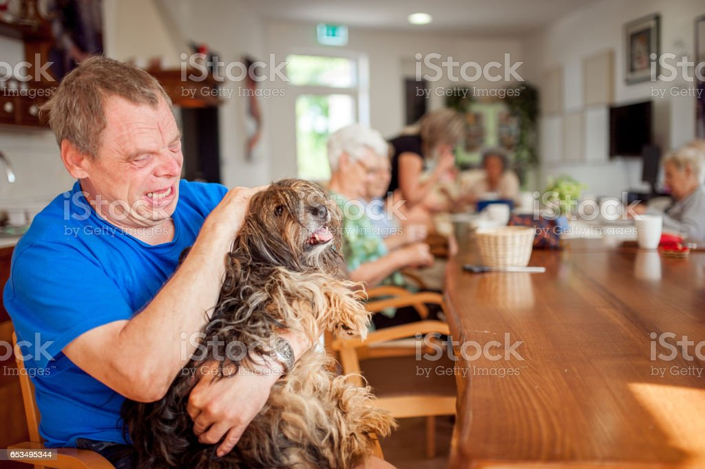 Pet Therapy In Elderly Day Care Center stock photo