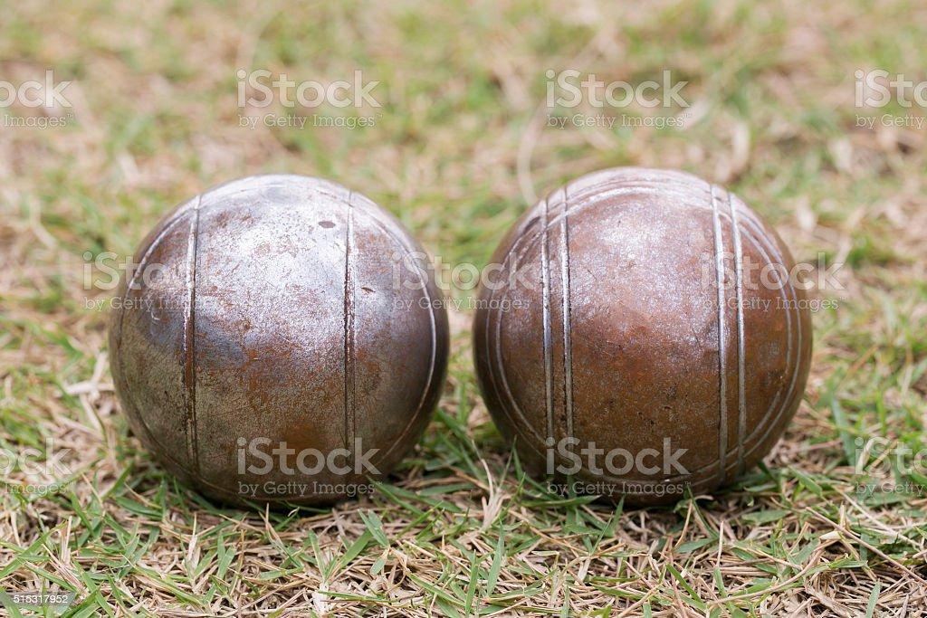 Petanque balls on the ground stock photo