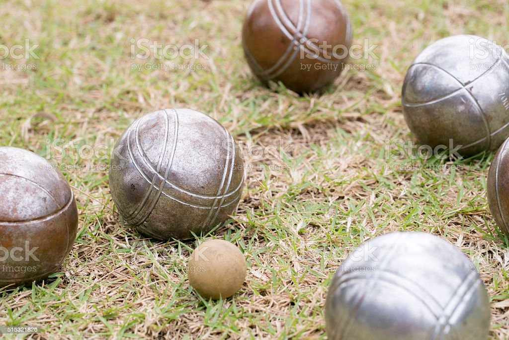 Petanque balls on the groundPetanque balls on the ground