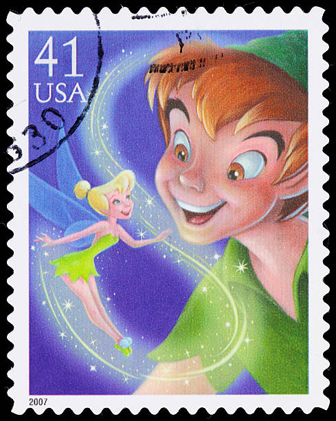 """USA Peter Pan and Tinker Bell postage stamp """"Sacramento, California, USA - May 6, 2011: A 2007 USA postage stamp with an illustration of Peter Pan and Tinker Bell from the Disney 1953 animated movie, Peter Pan."""" peter pan stock pictures, royalty-free photos & images"""