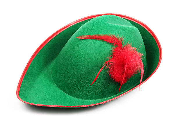 Peter Pan Hat on white Green hat with red feather in the style of classic 19th century children's book character Peter Pan. peter pan stock pictures, royalty-free photos & images