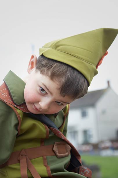 Peter Pan young boy dressed up Peter Pan young boy dressed up peter pan stock pictures, royalty-free photos & images