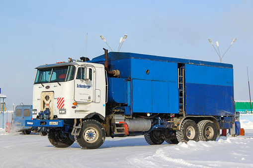 Novyy Urengoy, Russia - March 8, 2014: Schlumberger well service truck Peterbilt 362 in the city street.